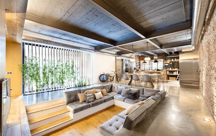 Mẫu phòng khách thiết kế chung không gian với bếp